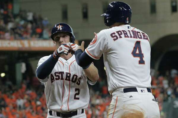 Houston Astros third baseman Alex Bregman (2) and Houston Astros right fielder George Springer (4) celebrate Bregman's two-run home run in the bottom of the third inning. Photos of game two between Houston Astros and Tampa Bay Rays on Saturday, Aug. 27, 2016, in Houston. Astros lead the series 1-0.