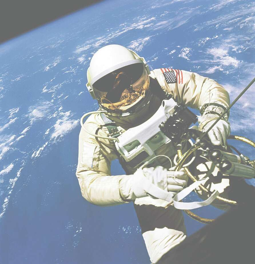 On June 3, 1965, while orbiting the Earth, astronaut Ed White spent 21 minutes outside the Gemini  IV spacecraft as it flew over the United States at an altitude of 103 miles.  / handout web