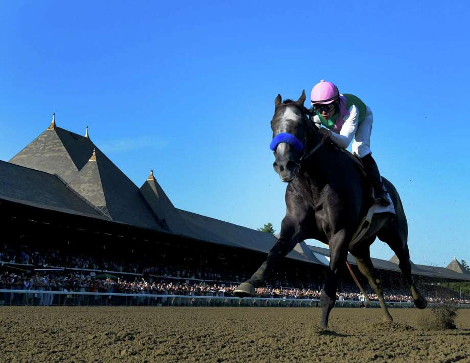 Arrogate with jockey Mike Smith wins the 147th running of the Travers Stakes at the Saratoga Race Course August 26, 2016 in Saratoga Springs, N.Y.    (Skip Dickstein/Times Union) Photo: SKIP DICKSTEIN / 20037808A