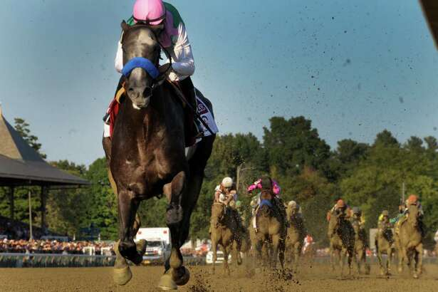 Arrogate with jockey Mike Smith wins the 147th running of the Travers Stakes at the Saratoga Race Course August 26, 2016 in Saratoga Springs, N.Y.    (Skip Dickstein/Times Union)