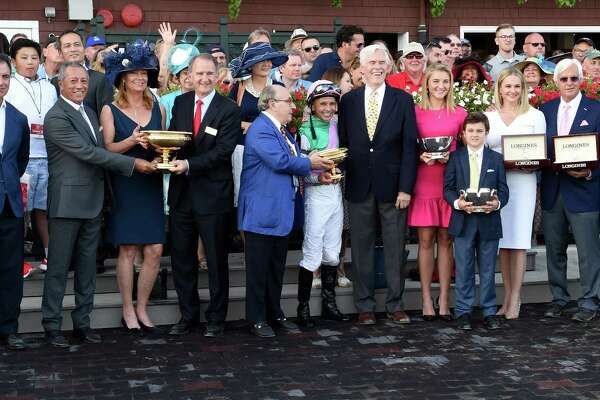 The winner's circle celebration after Arrogate with jockey Mike Smith wins the 147th running of the Travers Stakes at the Saratoga Race Course August 26, 2016 in Saratoga Springs, N.Y.    (Skip Dickstein/Times Union)