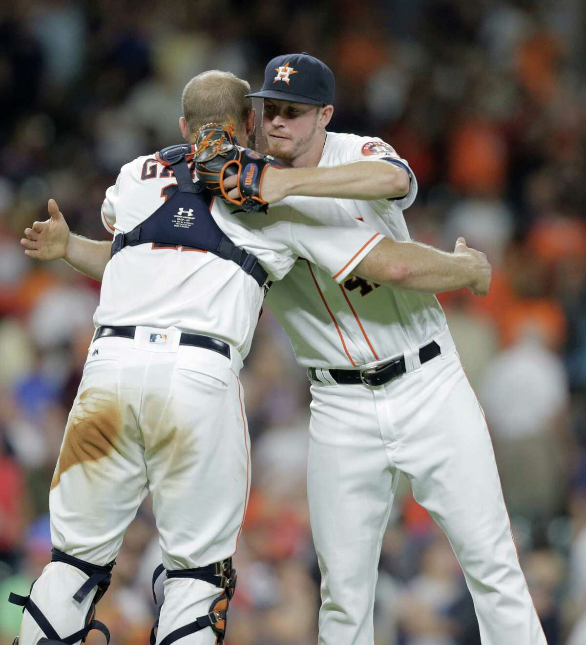 Houston Astros designated hitter Evan Gattis (11) and Houston Astros relief pitcher Chris Devenski (47) celebrate the 6-2 win over Tampa. Photos of game two between Houston Astros and Tampa Bay Rays on Saturday, Aug. 27, 2016, in Houston. Astros lead the series 1-0.
