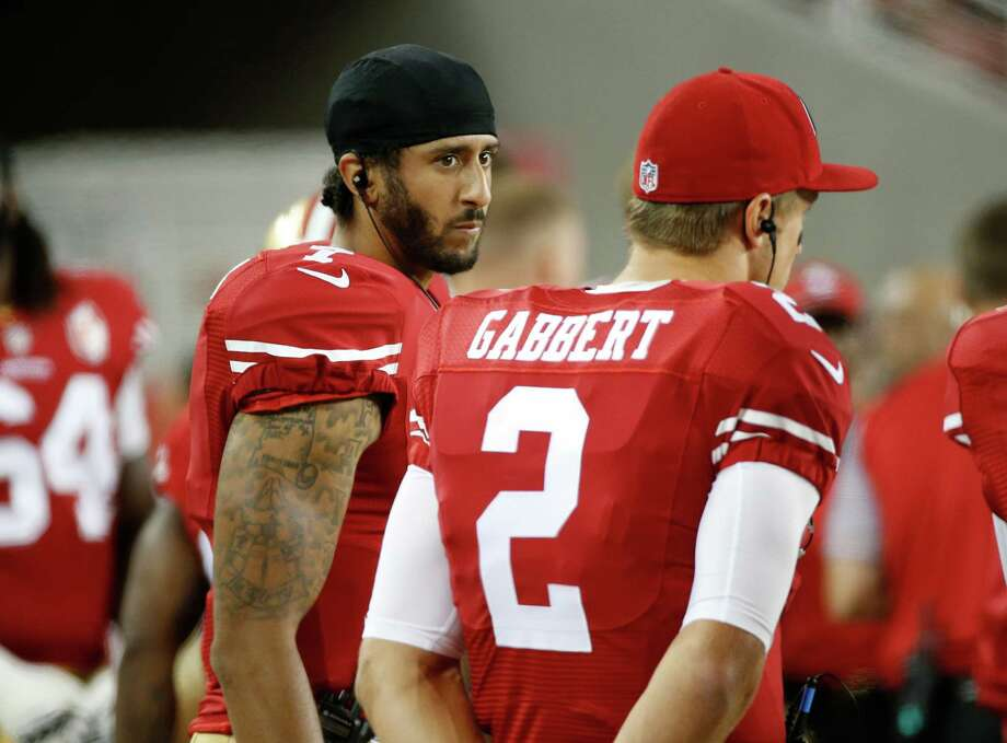 San Francisco 49ers quarterbacks Colin Kaepernick, left, and Blaine Gabbert stand on the sideline during the second half of an NFL preseason football game against the Green Bay Packers on Friday, Aug. 26, 2016, in Santa Clara, Calif. Green Bay won 21-10. (AP Photo/Tony Avelar) Photo: Tony Avelar, FRE / FR155217 AP