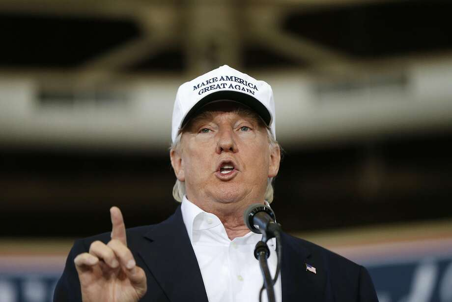 Donald Trump, campaigning Saturday in Iowa, is still trying to boost his support among suburban white voters. Photo: Gerald Herbert, Associated Press