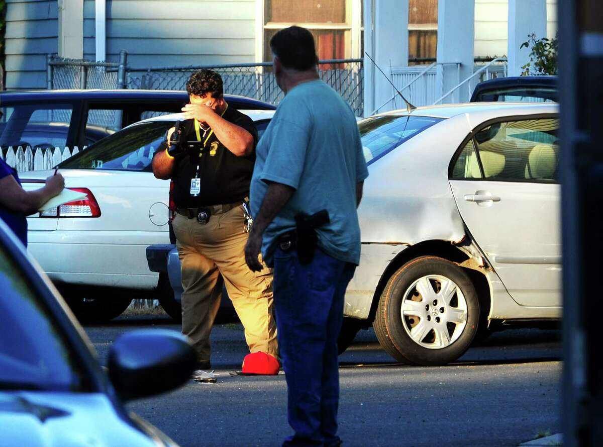 Police on scene at the fatal shooting of Shane Slinsky, 18, of Stamford, on Wood Terrace in Bridgeport, Conn., on Saturday Aug. 27, 2016.
