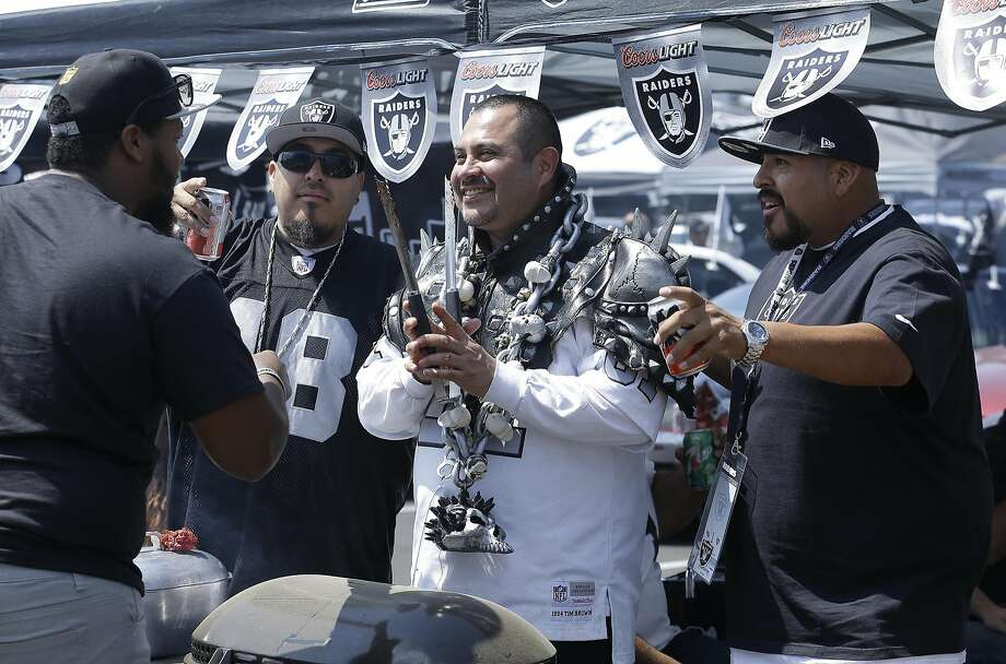Fans tailgate outside the Oakland Coliseum before the start of an NFL preseason football game between the Oakland Raiders and the Tennessee Titans Saturday, Aug. 27, 2016, in Oakland, Calif. (AP Photo/Ben Margot) Photo: Ben Margot, Associated Press