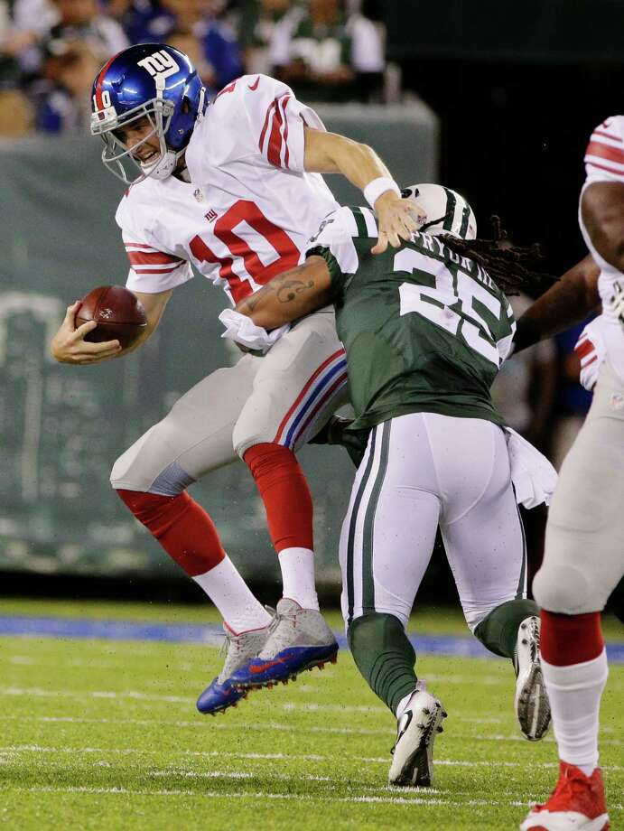 New York Giants quarterback Eli Manning (10) is sacked by New York Jets strong safety Calvin Pryor (25) during the first half of an NFL preseason football game Saturday, Aug. 27, 2016, in East Rutherford, N.J. (AP Photo/Peter Morgan) ORG XMIT: ERU105 Photo: Peter Morgan / Copyright 2016 The Associated Press. All rights reserved. This m