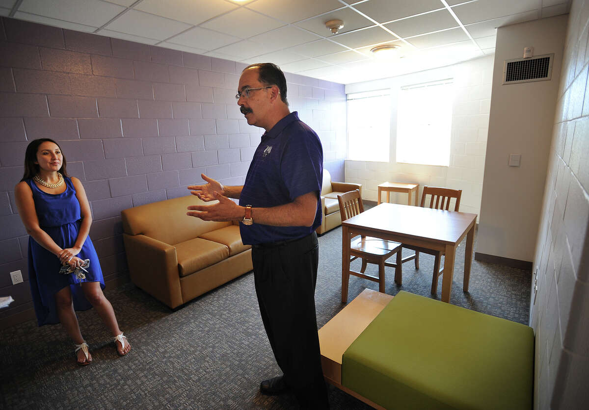 Resident Director Jessica DePalmer and Director of Operations George Estrada give a tour one of the suites in the University of Bridgeport's new University Hall dormitory in Bridgeport, Conn. on Wednesday, August 24, 2016.