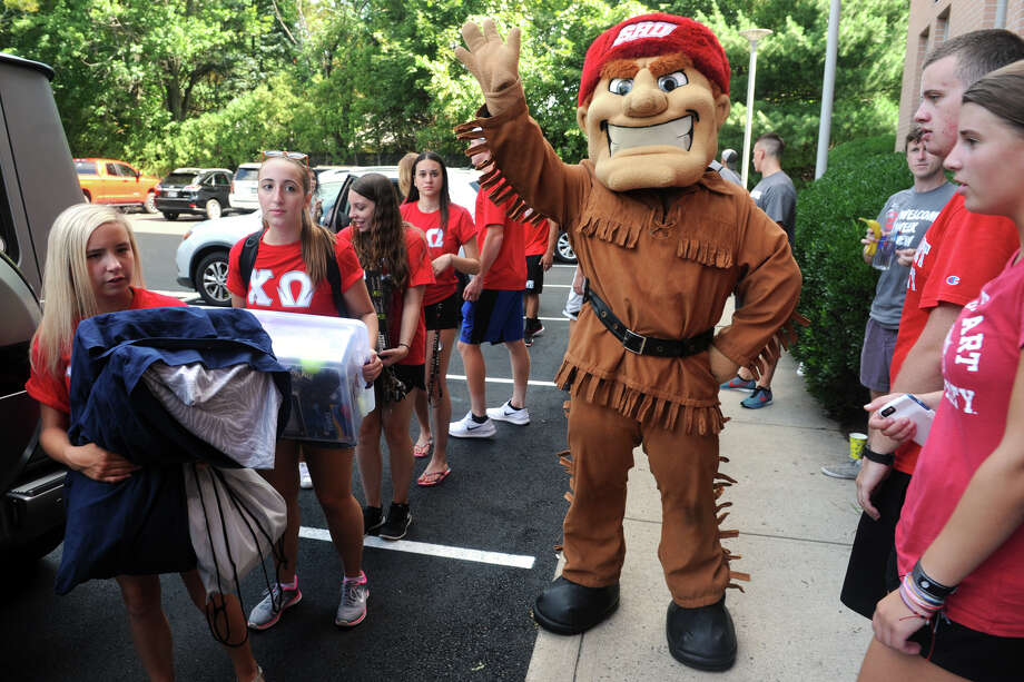 Big Red, the Sacred Heart University mascot, waves as upperclassmen help incoming freshmen move their belongings into Roncalli Hall. Photo: Ned Gerard / Hearst Connecticut Media / Connecticut Post