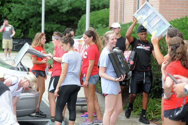 Upperclassmen help incoming freshmen move their belongings into Roncalli Hall, which stands in Bridgeport, across the street from the main campus of Sacred Heart University, in Fairfield, Conn. Aug. 26, 2016. Classes begin at Scared Heart on Monday.
