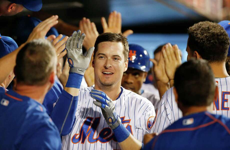 Teammates celebrate with New York Mets Kelly Johnson, center, after Johnson's seventh-inning, grand slam in a baseball game against the Philadelphia Phillies, Saturday, Aug. 27, 2016, in New York. (AP Photo/Kathy Willens) ORG XMIT: NYM117 Photo: Kathy Willens / Copyright 2016 The Associated Press. All rights reserved. This m