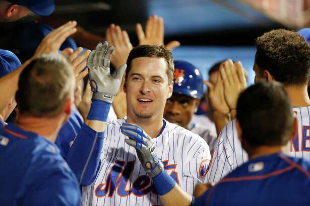 Teammates celebrate with New York Mets Kelly Johnson, center, after Johnson's seventh-inning, grand slam in a baseball game against the Philadelphia Phillies, Saturday, Aug. 27, 2016, in New York. (AP Photo/Kathy Willens) ORG XMIT: NYM117