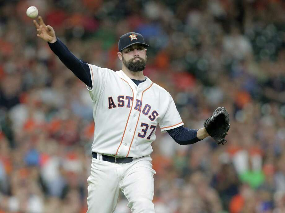 Houston Astros relief pitcher Pat Neshek (37) gets Tampa Bay Rays shortstop Matt Duffy (5) out in the eighth inning. Photos of game two between Houston Astros and Tampa Bay Rays on Saturday, Aug. 27, 2016, in Houston. Astros lead the series 1-0. Photo: Elizabeth Conley, Houston Chronicle / © 2016 Houston Chronicle