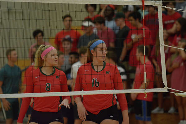 The Woodlands setter Sophie Walls, left, and outside hitter AJ Koele get ready to go to work against Kingwood during their pre-district matchup at TWHS on August 24, 2016. (Photo by Jerry Baker/Freelance)