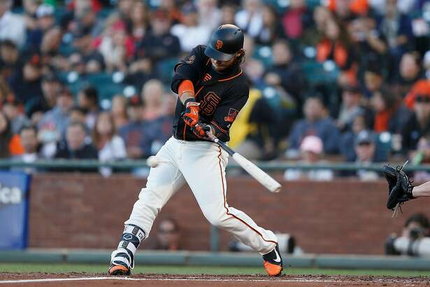 SAN FRANCISCO, CA - AUGUST 27: Brandon Crawford #35 of the San Francisco Giants hits a solo home run in the second inning against the Atlanta Braves at AT&T Park on August 27, 2016 in San Francisco, California. (Photo by Lachlan Cunningham/Getty Images)