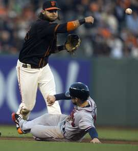 San Francisco Giants shortstop Brandon Crawford, top, throws over Atlanta Braves' Ender Inciarte to complete a double play during the fifth inning of a baseball game, Saturday, Aug. 27, 2016, in San Francisco. Freddie Freeman was out at first base. (AP Photo/D. Ross Cameron)