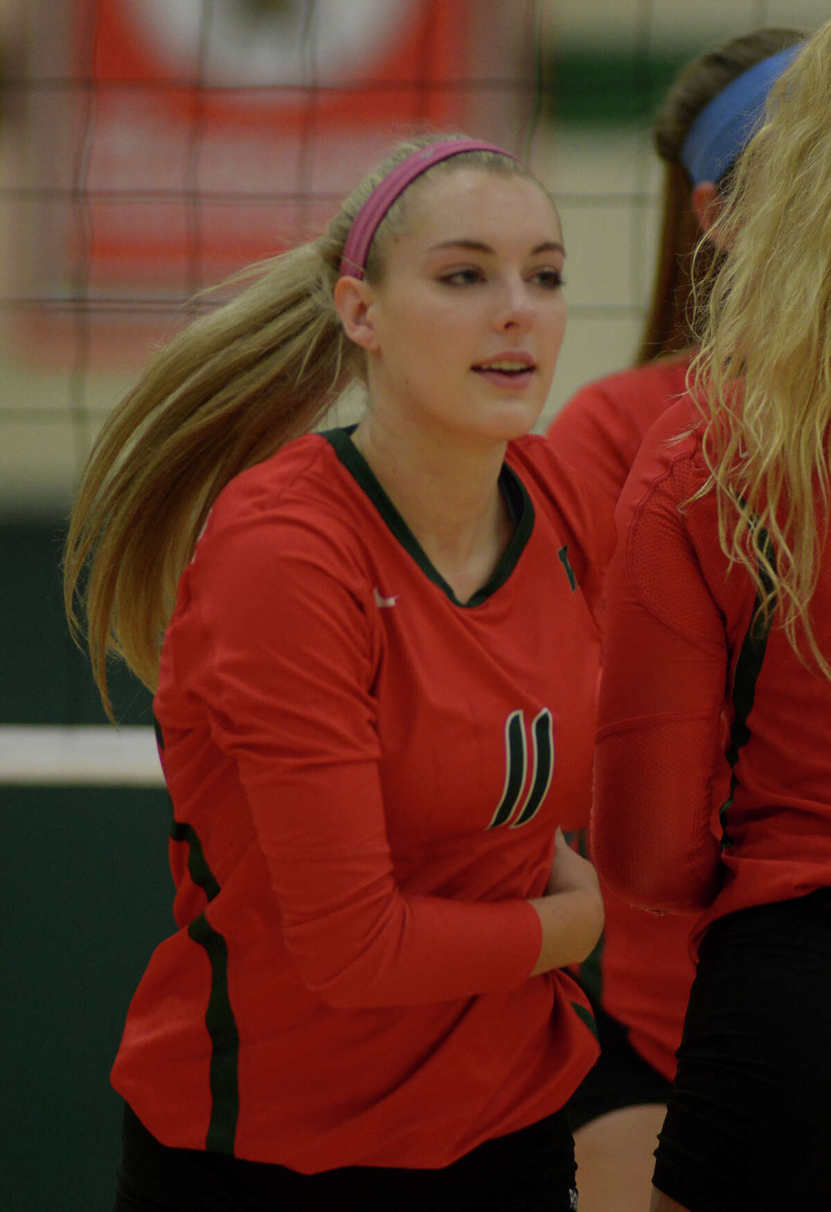 The Woodlands' Dayna Drake is all smiles during the Lady Highlander's non-district volleyball match against Kingwood at TWHS on August 24, 2016. (Photo by Jerry Baker/Freelance)