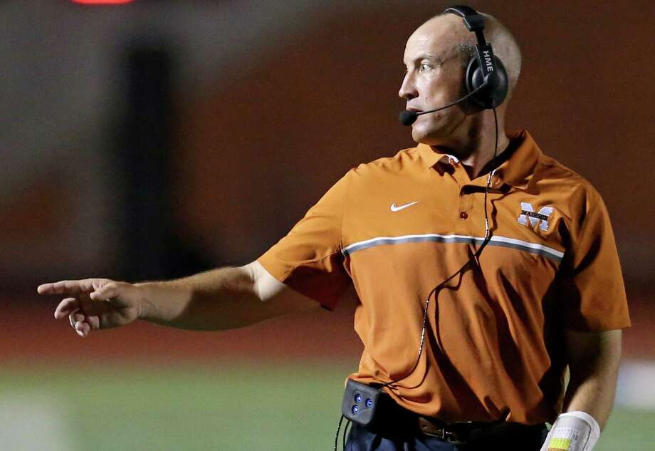Madison head coach John Campbell calls a play during second-half action against Steele on Aug. 27, 2016 at Heroes Stadium. According to public records from the district, Campbell would have received more than $100,000 for the 2016-2017 school year.Click ahead to view the San Antonio-area's top-paid head football coaches. Photo: Edward A. Ornelas /San Antonio Express-News / © 2016 San Antonio Express-News