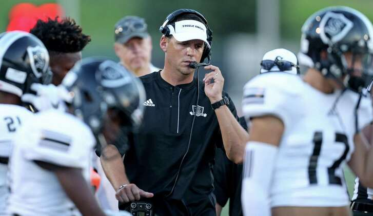 Steele coach Scott Lehnhoff walks the sidelines during first half action against Madison on Aug. 27, 2016 at Heroes Stadium.