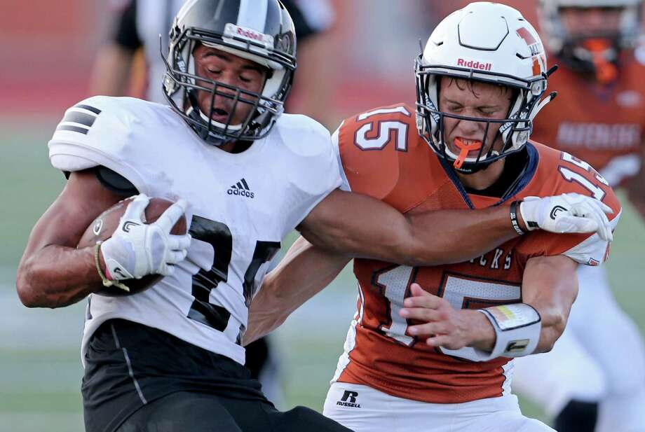 Steele's Brenden Brady looks for room around Madison's Jack Bellinger during first half action on Aug. 27, 2016 at Heroes Stadium. Photo: Edward A. Ornelas /San Antonio Express-News / © 2016 San Antonio Express-News