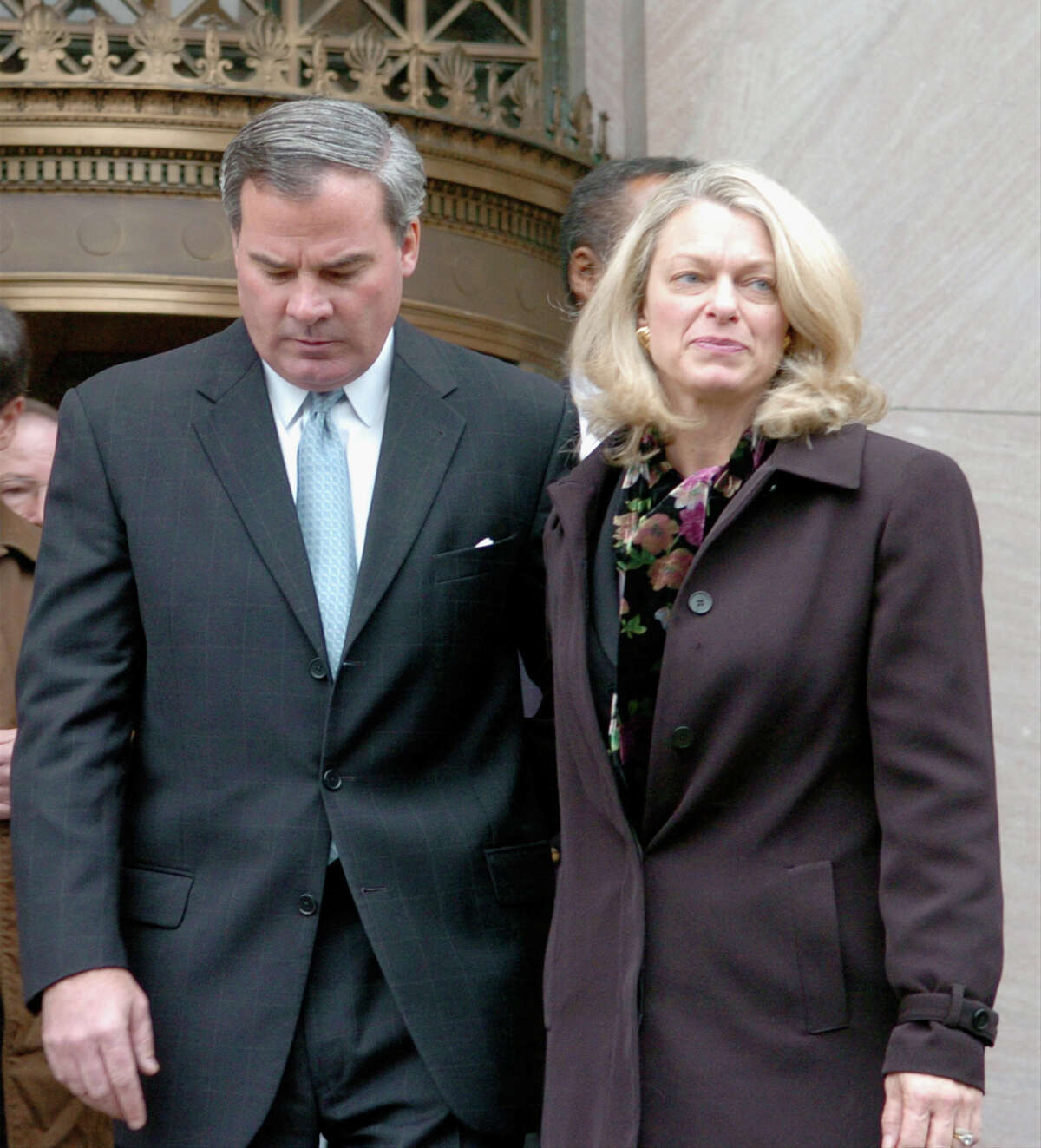Origin of a law: .After former Gov. John Rowland went to prison for accepting gifts from contractors, the state passed clean-election laws, which ban those who do business with the state from giving to a state political campaign. Here, Rowland and his wife Patty leave federal court after he pleaded guilty in 2004