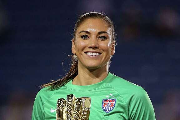 BOCA RATON, FL - MARCH 09:  Hope Solo #1 of the United States poses with the Golden Glove award after winning a match against Germany in the 2016 SheBelieves Cup at FAU Stadium on March 9, 2016 in Boca Raton, Florida.  (Photo by Mike Ehrmann/Getty Images)