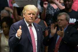 "(FILES) This file photo taken on August 22, 2016 shows Republican presidential nominee Donald Trump gestures following his speach during a campaign rally in Austin, Texas. Donald Trump is committed to a ""fair and humane"" approach to securing America's borders, but details of his evolving immigration policy will be revealed at a later time, his presidential campaign team said on  August 28, 2016. The Republican presidential candidate's hardline stance on repatriating the 11 million undocumented immigrants in the United States has been a central tenet of Trump's White House campaign -- and a hugely popular selling point to his most ardent supporters. To keep illegal migrants out, Trump has promised to build a wall on America's southern border -- to be paid for, he has declared at rally after campaign rally, by Mexico.  / AFP PHOTO / SUZANNE CORDEIROSUZANNE CORDEIRO/AFP/Getty Images"