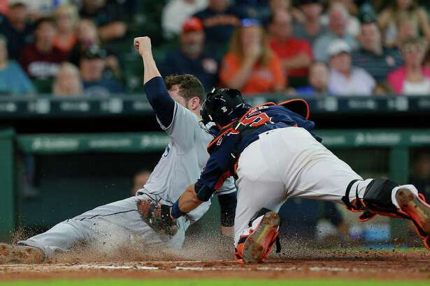 HOUSTON, TX - AUGUST 28:  Steven Souza Jr. #20 of the Tampa Bay Rays avoids the tag attempt by Jason Castro #15 of the Houston Astros to score in the fourth inning at Minute Maid Park on August 28, 2016 in Houston, Texas.