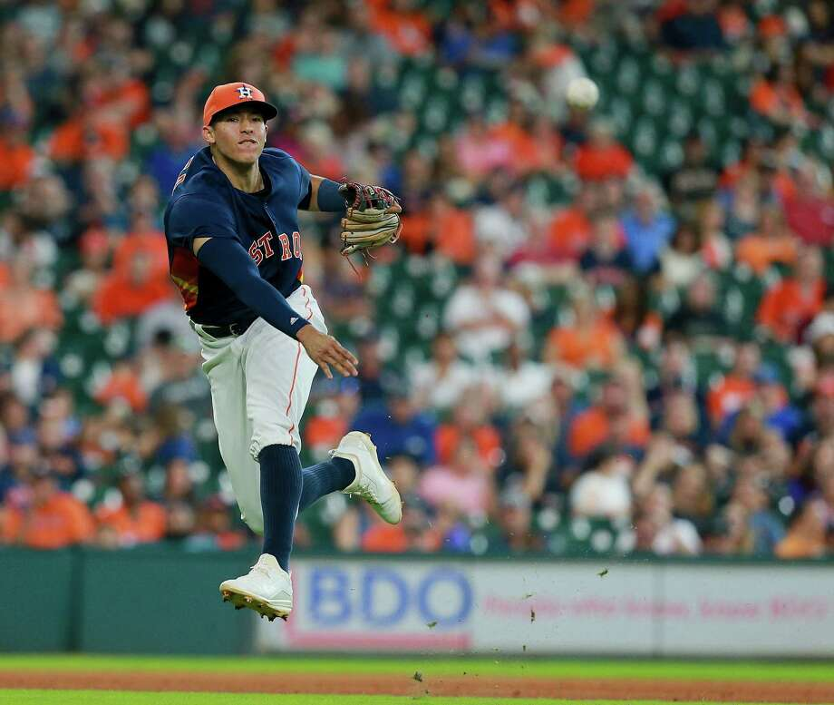 HOUSTON, TX - AUGUST 28:  Carlos Correa #1 of the Houston Astros throws out Tim Beckham #1 of the Tampa Bay Rays in the sixth inning at Minute Maid Park on August 28, 2016 in Houston, Texas. Photo: Bob Levey, Getty Images / 2016 Getty Images
