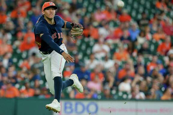 HOUSTON, TX - AUGUST 28:  Carlos Correa #1 of the Houston Astros throws out Tim Beckham #1 of the Tampa Bay Rays in the sixth inning at Minute Maid Park on August 28, 2016 in Houston, Texas.