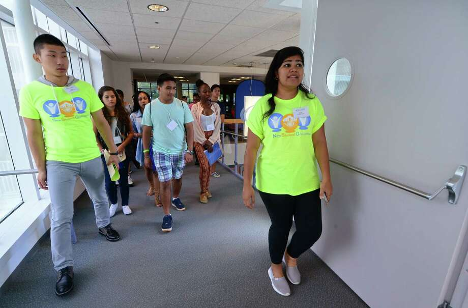 Returning students Jason An and Sana Akbar lead new students on a tour of the campus during orientation at Norwalk Community College on Frida. NCC was recently awarded a $2.3 million grant based on its student diversity. Photo: Erik Trautmann / Hearst Connecticut Media / Norwalk Hour