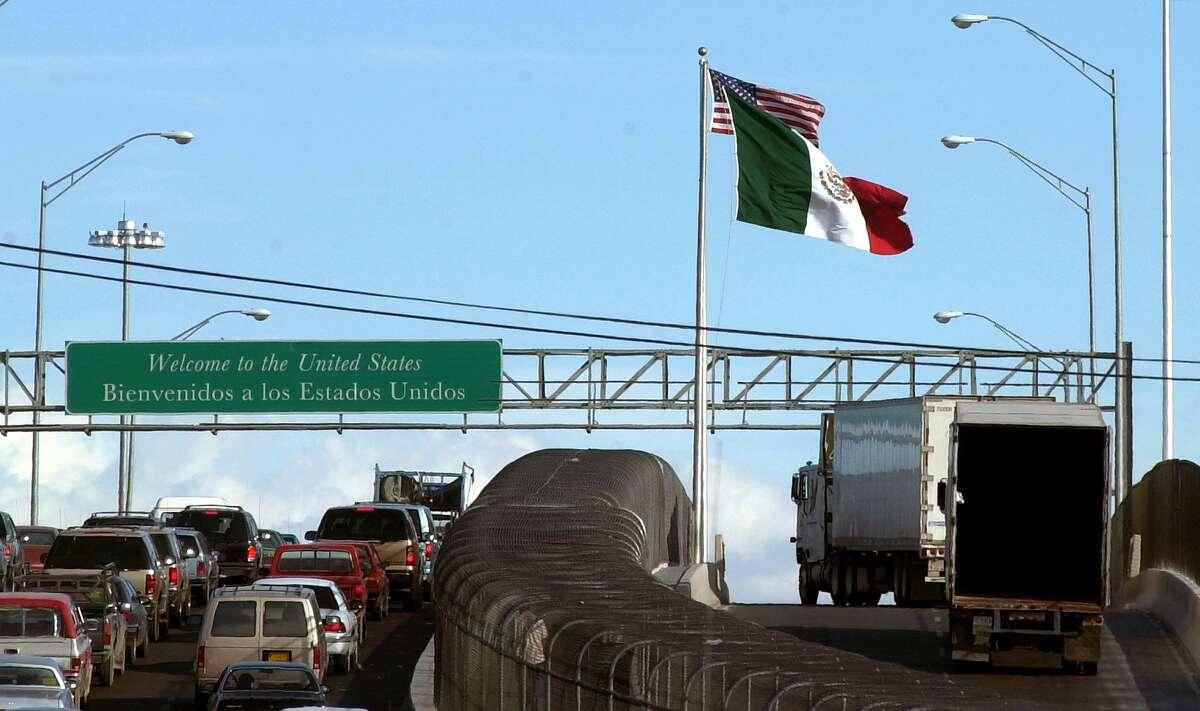 Mexican trucks drive on an international bridge leading to El Paso (Associated Press)