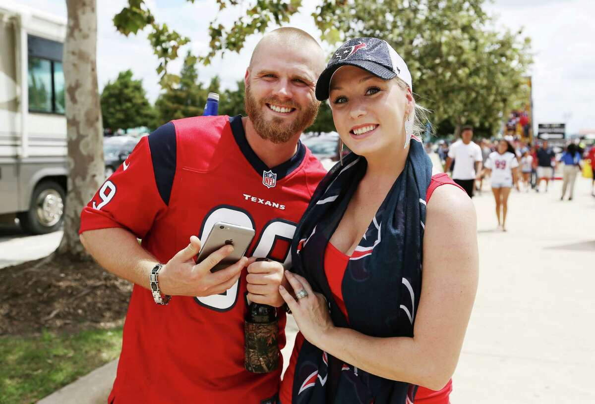 People pose for a photo at the parking lot of NRG Stadium before the Houston Texans v.s. Arizona Cardinals pre-season game Sunday, Aug. 28, 2016, in Houston.