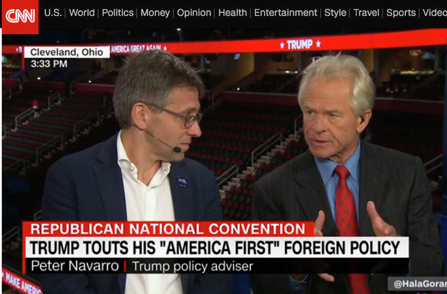 Political scientist Ian Bremmer (left) appears on CNN with Peter Navarro, Donald Trump's senior policy adviser, at the Republican National Convention.