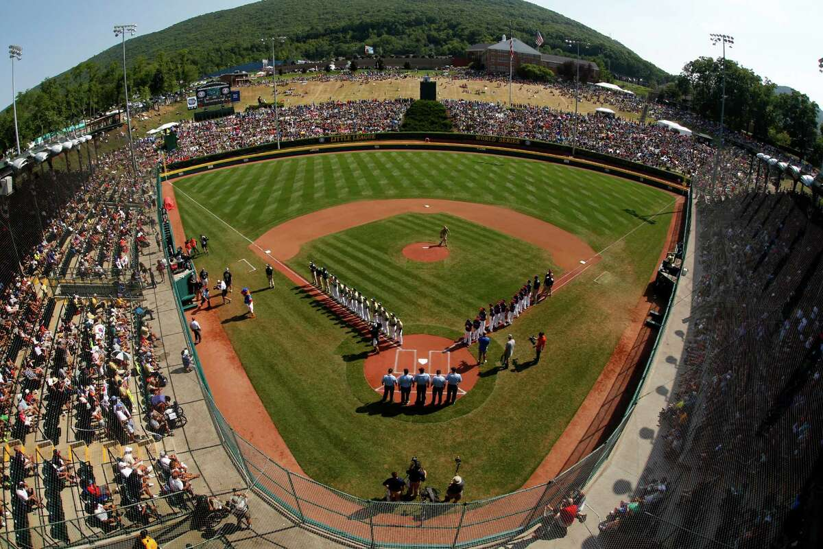 South Korea lines the third baseline and Endwell, N.Y., lines the first baseline during team introductions before the Little League World Series Championship baseball game at Lamade Stadium in South Williamsport, Pa., Sunday, Aug. 28, 2016.