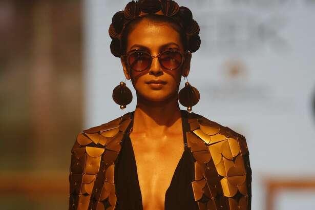 A model displays creations by Shivan and Narresh during the Lakme Fashion Week in Mumbai, India, Saturday, Aug.27, 2016. (AP Photo/Rajanish Kakade)