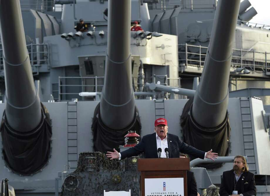 -- AFP PICTURES OF THE YEAR 2015 -- Republican presidential candidate Donald Trump gives a national security speech aboard the World War II Battleship USS Iowa, September 15, 2015, in San Pedro, California.   AFP PHOTO /ROBYN BECKROBYN BECK/AFP/Getty Images ORG XMIT: AFP PICTU ORG XMIT: MER2016082512205327 Photo: ROBYN BECK / AFP
