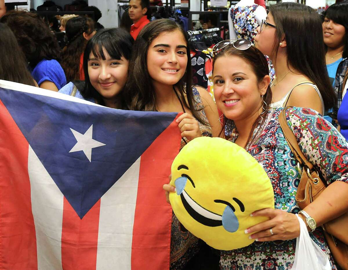 Fans of CNCO wait for their show at Macy's in Memorial City Mall Sunday Aug. 28, 2016. (Dave Rossman Photo)