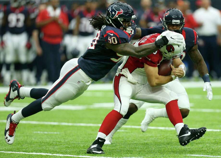 Houston Texans outside linebacker Jadeveon Clowney (90) tackles Arizona Cardinals quarterback Drew Stanton (5) after Stanton was forced out of the pocket for a two-yard gain during the second quarter of an NFL pre-season football game at NRG Stadium on Sunday, Aug. 28, 2016, in Houston. Photo: Brett Coomer, Houston Chronicle / © 2016 Houston Chronicle