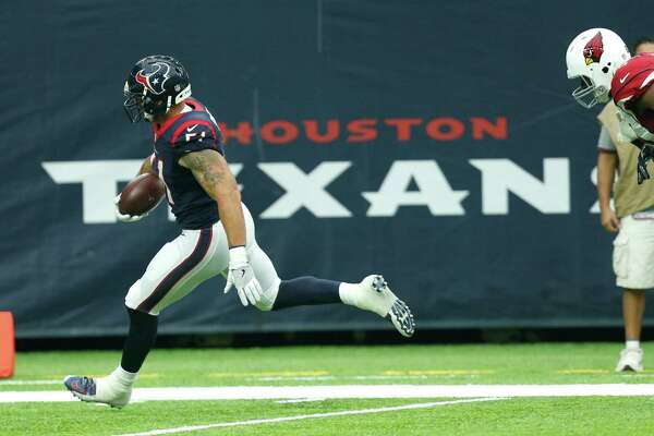 Houston Texans outside linebacker John Simon (51) runs past Arizona Cardinals tight end Darren Fells (85) as he returns an interception 59 yard for a touchdown during the second quarter of an NFL pre-season football game at NRG Stadium on Sunday, Aug. 28, 2016, in Houston.