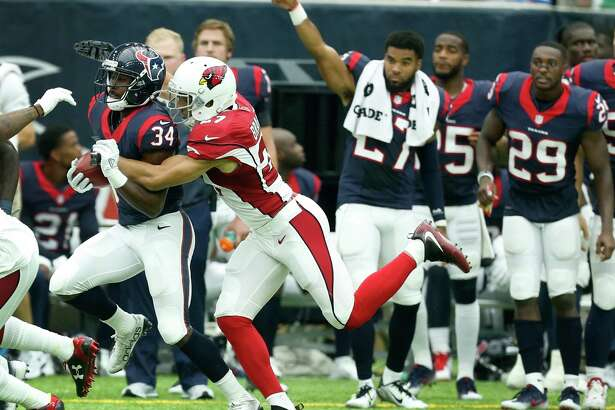 Houston Texans running back Tyler Ervin (34) is tackled by Arizona Cardinals defensive back Tyvon Branch (27) as he returns a kick during the second quarter of an NFL pre-season football game at NRG Stadium on Sunday, Aug. 28, 2016, in Houston.