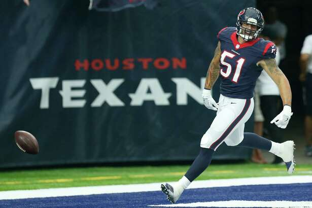 Houston Texans outside linebacker John Simon (51) spikes the football after returning an interception 59 yard for a touchdown against the Arizona Cardinals during the second quarter of an NFL pre-season football game at NRG Stadium on Sunday, Aug. 28, 2016, in Houston.