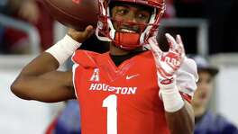 FILE- In this Nov. 14, 2015, file photo, Houston quarterback Greg Ward Jr. (1) warms up before an NCAA college football game against Memphis, in Houston. The pool of candidates for the Heisman Trophy is deep. Stanford's Christian McCaffrey and Clemson's Deshaun Watson are among the obvious ones, and Ward could enter the race if things break right for him. (AP Photo/David J. Phillip, File)