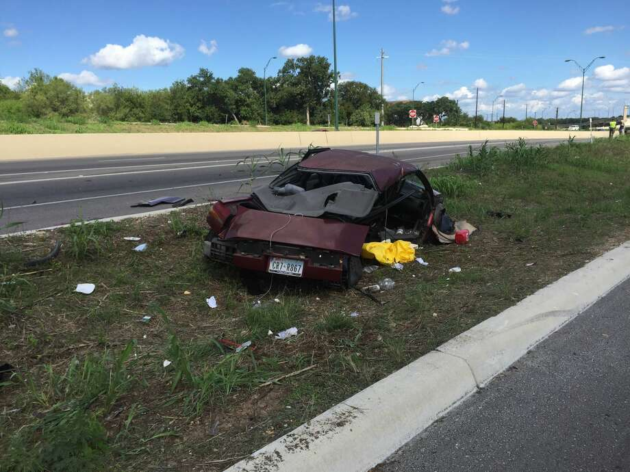 At least 10 San Antonio Fire Department units responded to a rollover crash on the North Side that left two in critical condition Sunday afternoon, Aug. 28, 2016. Photo: By Quixem Ramirez