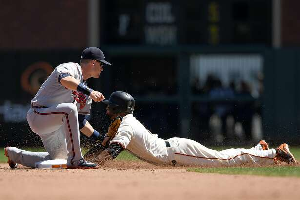 SAN FRANCISCO, CA - AUGUST 28:  Eduardo Nunez #10 of the San Francisco Giants gets caught stealing tagged out by Gordon Beckham #7 of the Atlanta Braves in the bottom of the fourth inning at AT&T Park on August 28, 2016 in San Francisco, California.  (Photo by Thearon W. Henderson/Getty Images)