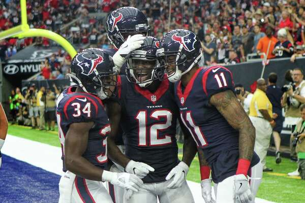Houston Texans wide receiver Jaelen Strong (11) celebrates wit teammates running back Tyler Ervin (34) and wide receiver Keith Mumphery (12) after scoring a touchdown during the second quarter of an NFL pre-season football game at NRG Stadium on Sunday, Aug. 28, 2016, in Houston.