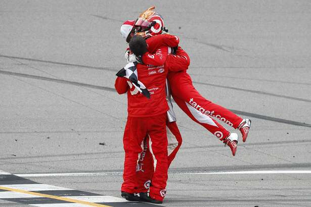 Kyle Larson celebrates with crew members after winning the NASCAR Sprint Cup Series auto race at Michigan International Speedway in Brooklyn, Mich., Sunday, Aug. 28, 2016. (AP Photo/Paul Sancya)