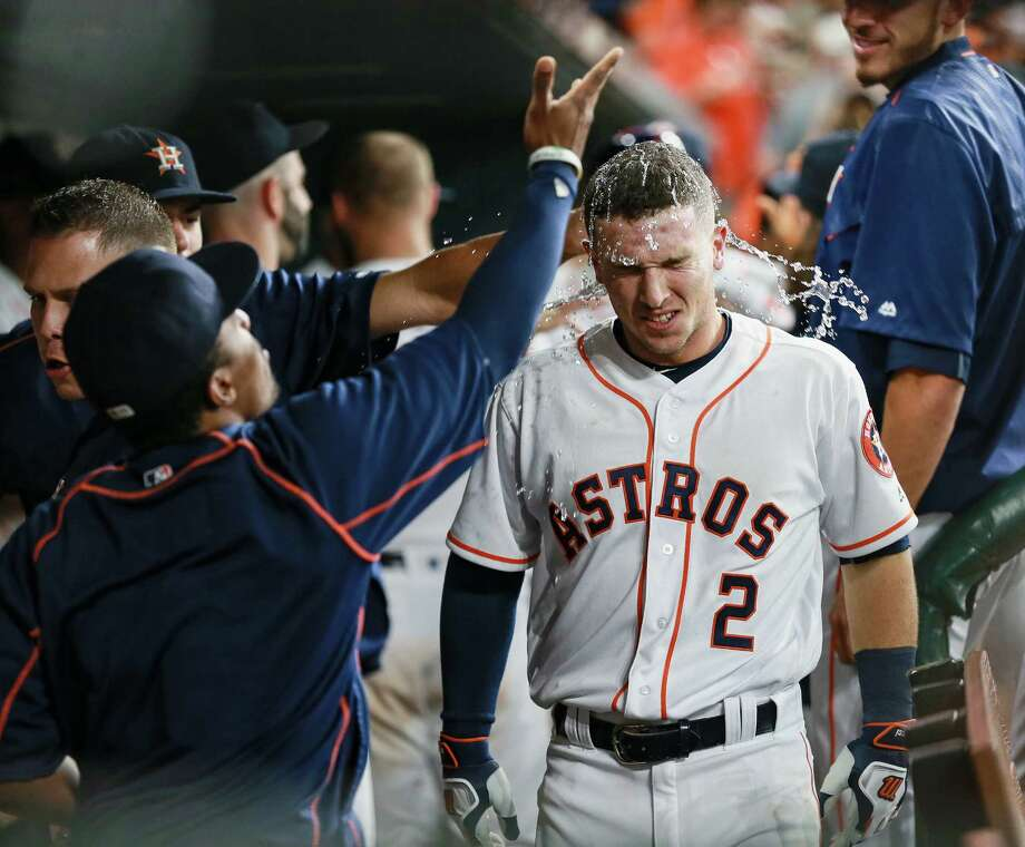 HOUSTON, TX - AUGUST 27: Alex Bregman #2 of the Houston Astros is doused with water and sunflower seeds after hitting a home run in the third inning against the Tampa Bay Rays at Minute Maid Park on August 27, 2016 in Houston, Texas. (Photo by Bob Levey/Getty Images) Photo: Bob Levey, Stringer / Getty Images / 2016 Getty Images