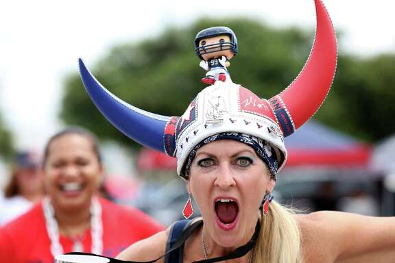 A Texans fan poses for a photo at the parking lot of NRG Stadium before the Houston Texans v.s. Arizona Cardinals pre-season game Sunday, Aug. 28, 2016, in Houston.