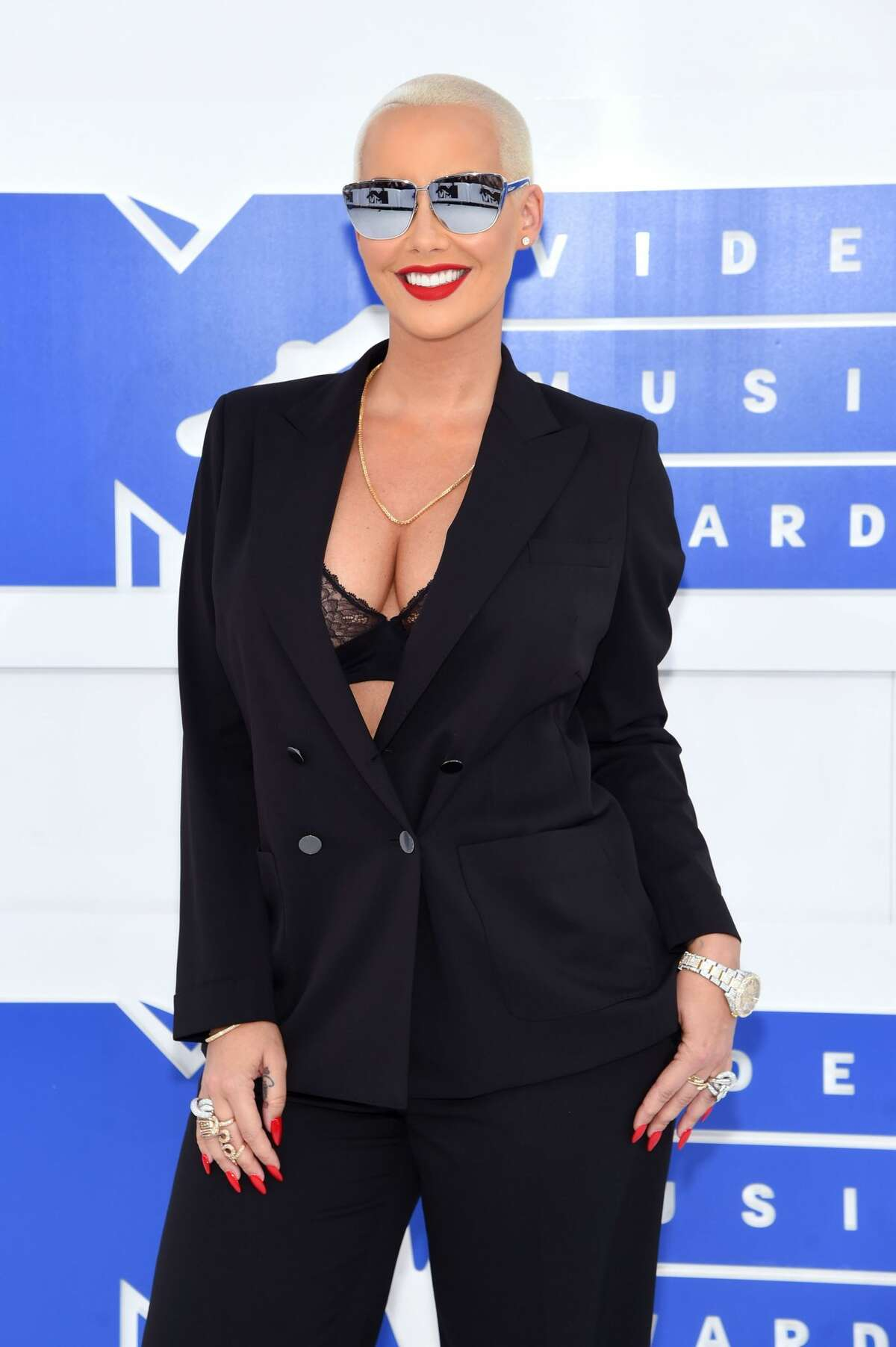 Best: Amber Rose Best, in the sense that an understated black suit with one's bra showing counts.